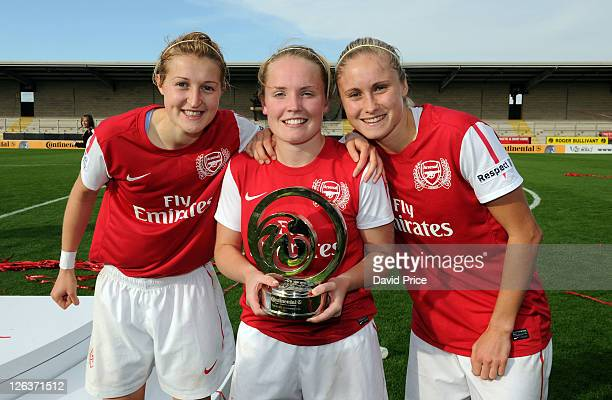 Ellen White Kim Little and Steph Houghton of Arsenal pose with the League Cup trophy following the FA WSL Continental Cup Final between Birmingham...