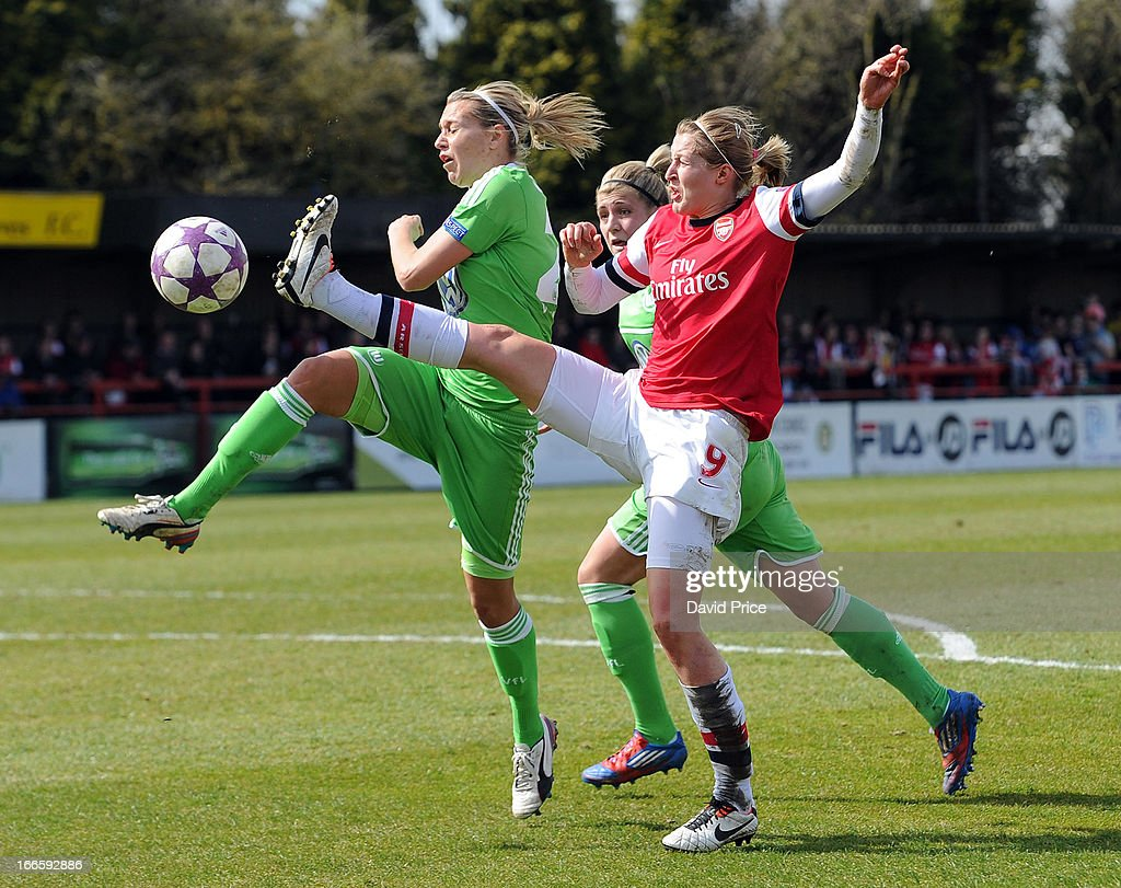 Ellen White (R) of Arsenal Ladies FC challenges Lena Goessling of Wolfsburg during the Women's Champions League Semi Final match between Arsenal Ladies FC and VfL Wolfsburg at Meadow Park on April 14, 2013 in Borehamwood, United Kingdom.