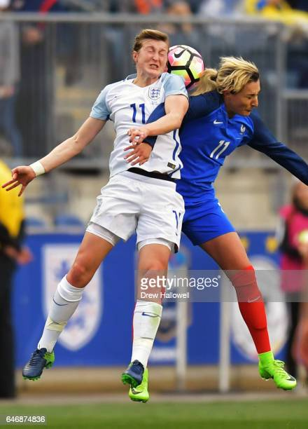 Ellen White of England and Claire Lavogez of France go up to head the ball during the SheBelieves Cup at Talen Energy Stadium on March 1 2017 in...