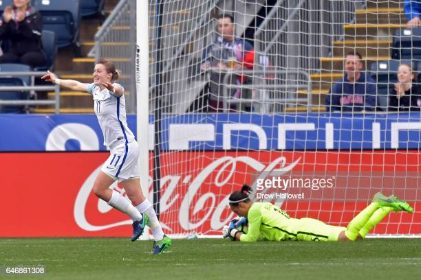 Ellen White of England celebrates a teammate's goal as she passes goalkeeper Sarah Bouhaddi of France during the SheBelieves Cup at Talen Energy...
