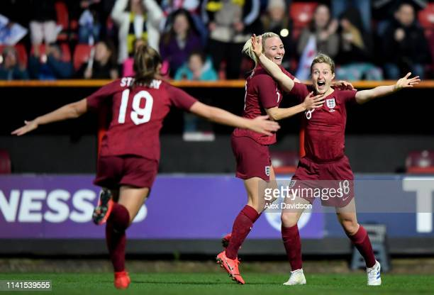 Ellen White of England celebrates scoring her teams second goal with Toni Duggan and Georgia Stanway of England during the International Friendly...