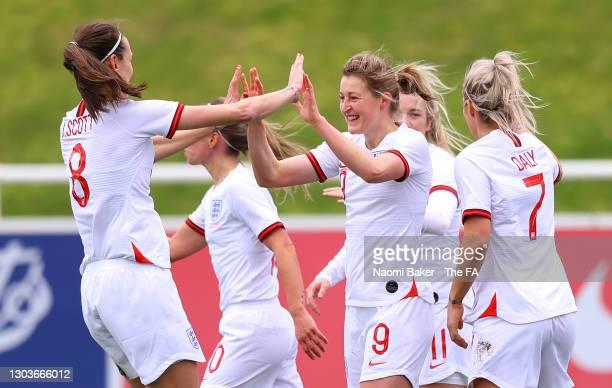 Ellen White of England celebrates with teammate Jill Scott after scoring their team's first goal during the Women's International Friendly match...