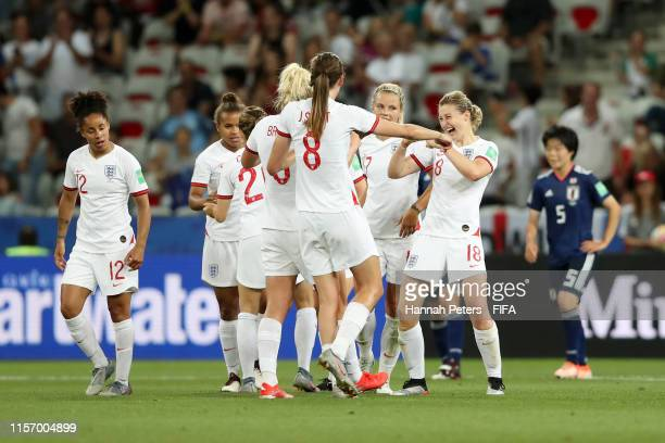 Ellen White of England celebrates with teammates after scoring her team's second goal during the 2019 FIFA Women's World Cup France group D match...