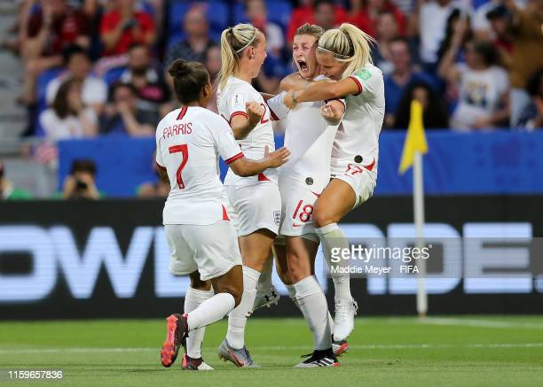 Ellen White of England celebrates with teammates after scoring her team's first goal during the 2019 FIFA Women's World Cup France Semi Final match...