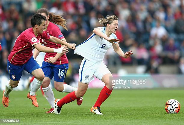 Ellen White of England has her shirt pulled by Mirela Tenkov of Serbia during the UEFA Women's European Championship Qualifying match between England...