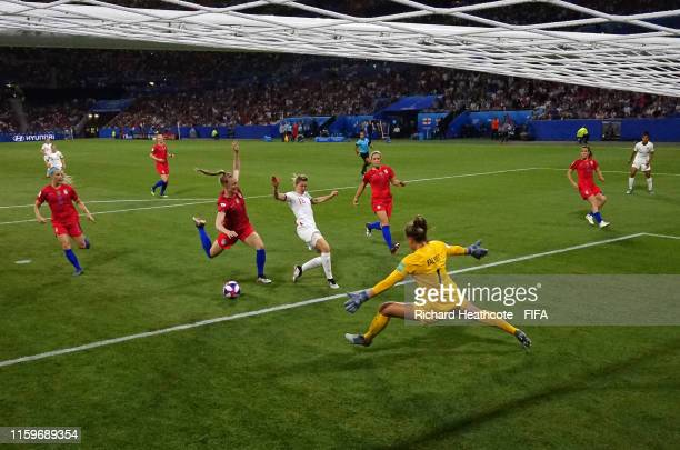Ellen White of England is fouled by Becky Sauerbrunn of the USA inside the penalty area, which leads to England being awarded a penalty following a...