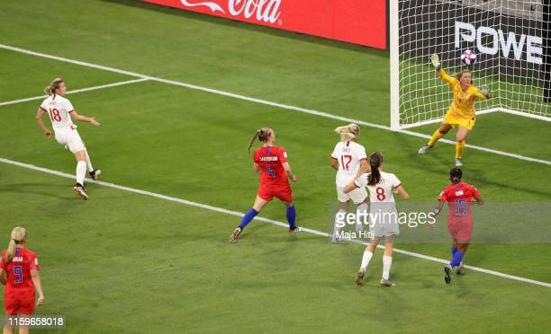 Ellen White of England scores her team's first goal past Alyssa Naeher of the USA during the 2019 FIFA Women's World Cup France Semi Final match...