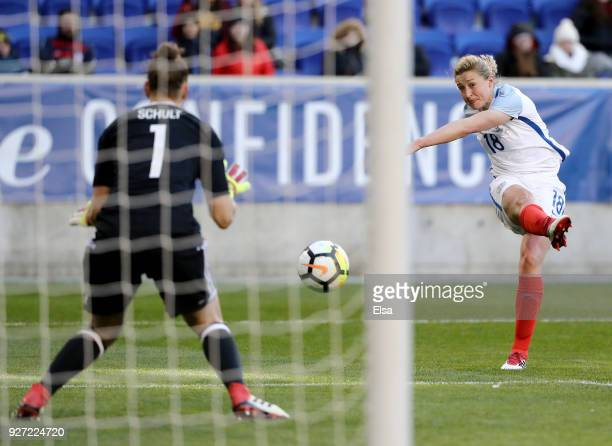 Ellen White of England takes a shot as Almuth Schult of Germany makes the stop in the second half during the SheBelieves Cup at Red Bull Arena on...