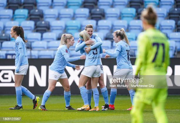 Ellen White of Manchester City celebrates after scoring her teams second goal during the Women's UEFA Champions League Round of 16 match between...