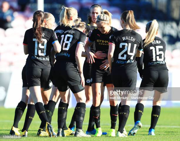 Ellen White of Manchester City celebrates with Steph Houghton after scoring her teams first goal during the Barclays FA Women's Super League match...