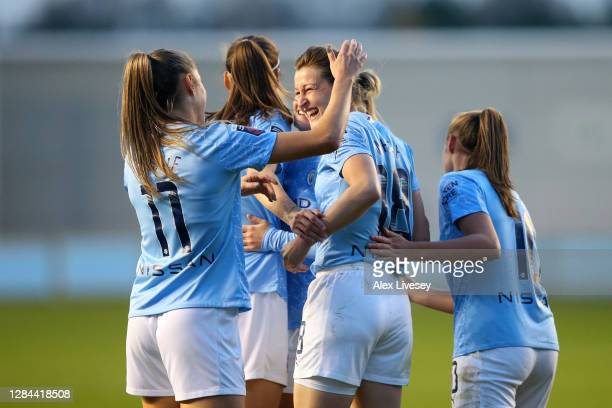 Ellen White of Manchester City celebrates with teammates after scoring her team's sixth goal during the Barclays FA Women's Super League match...