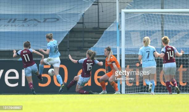 Ellen White of Manchester City scores their team's second goal during the Vitality Women's FA Cup Fourth Round match between Manchester City Women...