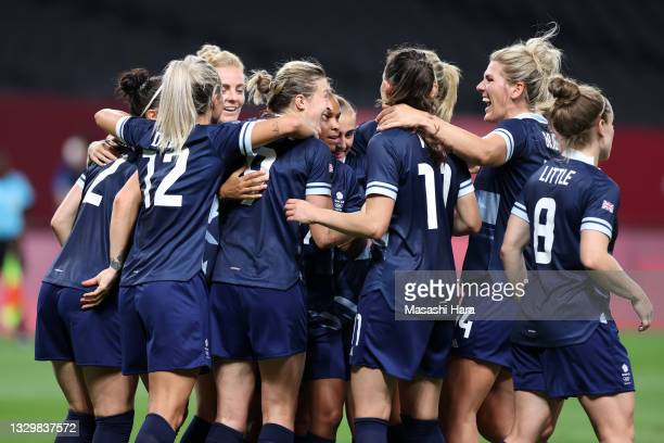 Ellen White of Team Great Britain celebrates with Millie Bright and teammates after scoring their side's second goal during the Women's First Round...