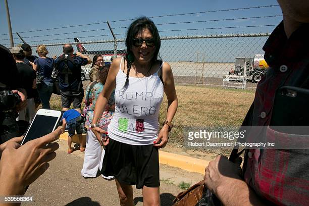 Elli Salazar of San Antonio Texas wears a handpainted tshirt with the words 'Trump culero' at the Laredo Texas airport where Mr Trump's private...