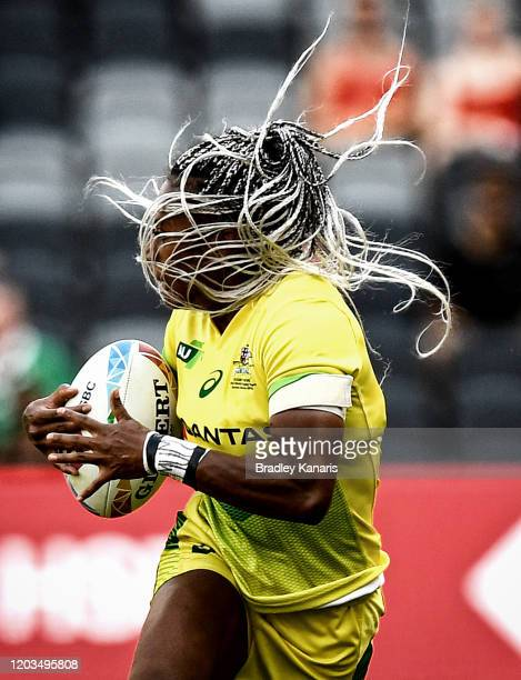 Ellia Green of Australia breaks away from the defence during the 2020 Sydney Sevens match between Australia and Ireland at Bankwest Stadium on...