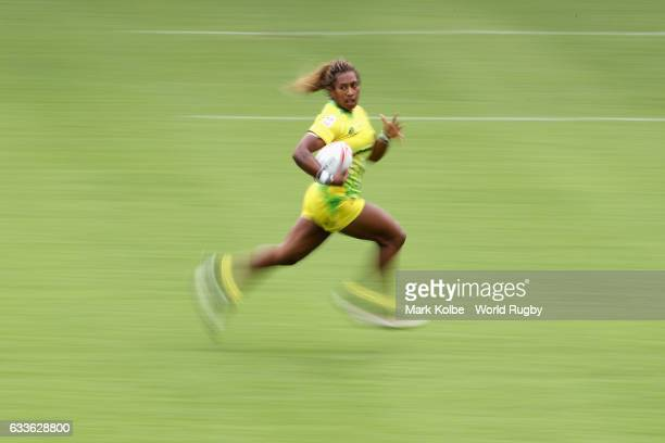 Ellia Green of Australia breaks away to score a try during the womens Pool B match between Australia and Ireland in the 2017 HSBC Sydney Sevens at...