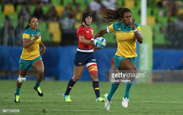 Ellia Green of Australia carries the ball against Spain during the Women's Quarterfinal 1 rugby match on Day 2 of the Rio 2016 Olympic Games at...