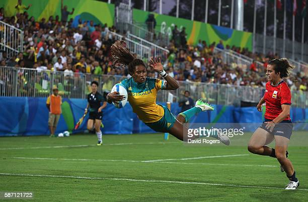 Ellia Green of Australia dives in to score a try against Patricia Garcia of Spain during the Women's Quarter-final 1 rugby match on Day 2 of the Rio...