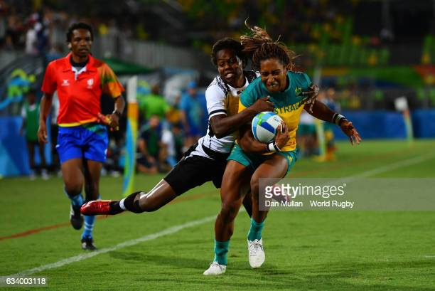 Ellia Green of Australia dives over for a try as she is tackled by Raijieli Daveua of Fiji during the Women's Rugby Sevens Pool A match between...