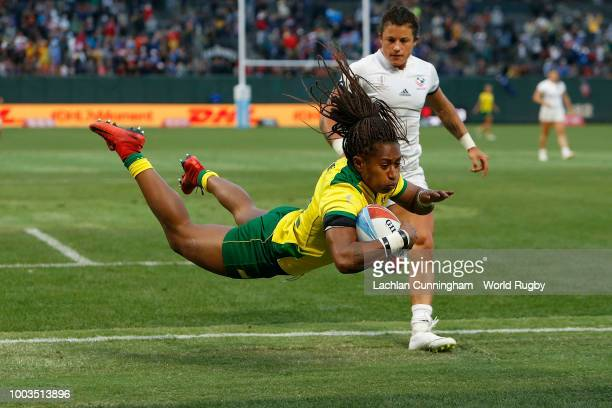Ellia Green of Australia dives over to score a try against the United States in the Bronze medal match on day two of the Rugby World Cup Sevens at...