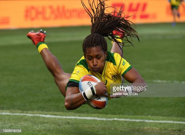 Ellia Green of Australia dives to score a try against the US during the Championships Bronze Final for third place at the Rugby Sevens World Cup in...
