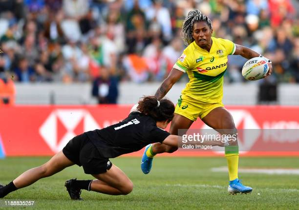 Ellia Green of Australia is tackled by Ruby Tui of New Zealand during day 3 of the 2019 HSBC Cape Town Sevens women's final match between Australia...