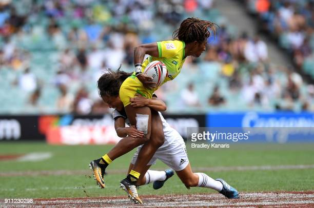 Ellia Green of Australia looks to pass in the Women's Final match against New Zealand during day three of the 2018 Sydney Sevens at Allianz Stadium...