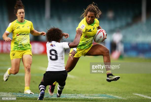 Ellia Green of Australia puts a fend on Ana Maria Roqica of Fiji during the womens pool match between Australia and Fiji in the 2017 HSBC Sydney...