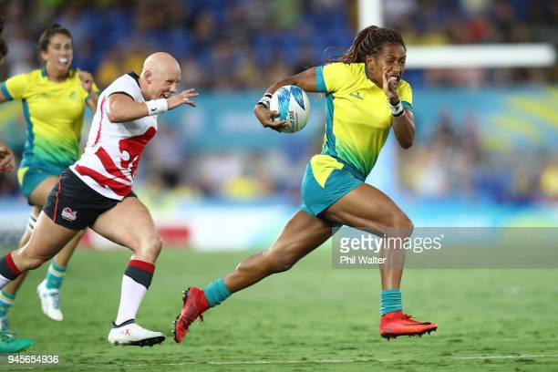 Ellia Green of Australia runs in for a try in the match between Australia and England during Rugby Sevens on day nine of the Gold Coast 2018...