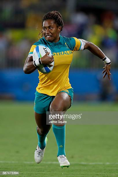 Ellia Green of Australia runs with the ball during the Women's Gold Medal Rugby Sevens match between Australia and New Zealand on Day 3 of the Rio...