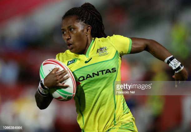 Ellia Green of Australia runs with the ball on day one of the Emirates Dubai Rugby Sevens HSBC World Rugby Sevens Series at The Sevens Stadium on...