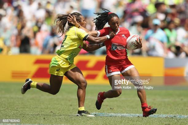 Ellia Green of Australia tackles Charity Williams of Canada during the womens cup semi final match between Australia and Canada in the 2017 HSBC...