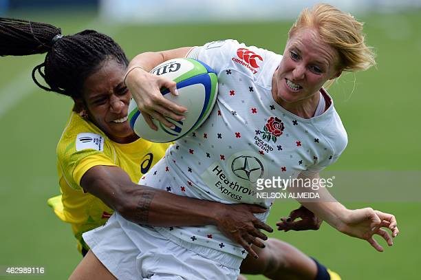 Ellia Green of Australia tackles from Michaela Staniford of England during their quarter final match of the IRB Women's Sevens World Series in...