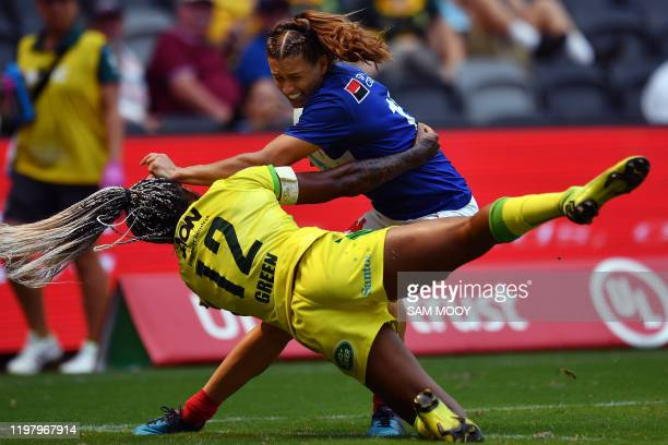 Ellia Green of Australia tackles Lina Guerin of France in their women's match during the Sydney Sevens rugby tournament at Bankwest Stadium in Sydney...