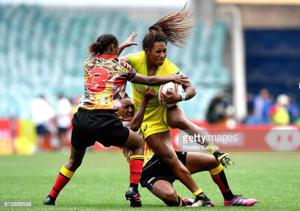 Ellia Green of Australia takes on the defence in the match against Papau New Guinea during day one of the 2018 Sydney Sevens at Allianz Stadium on...