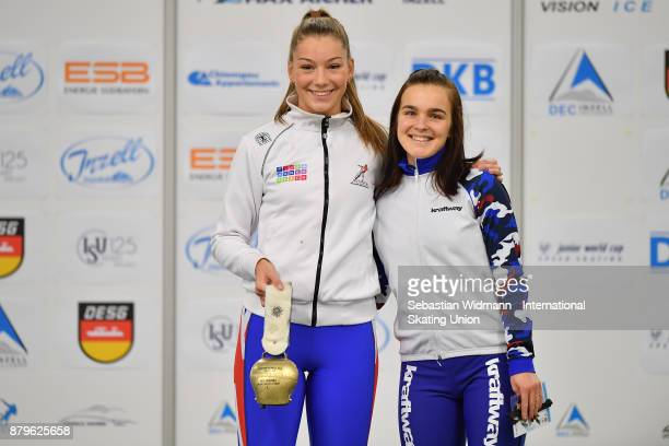 Ellia Smeding of Great Britain and Anastasiia Zuevapose of Russia pose during the medal ceremony of the Ladies mass start the ISU Neo Senior World...