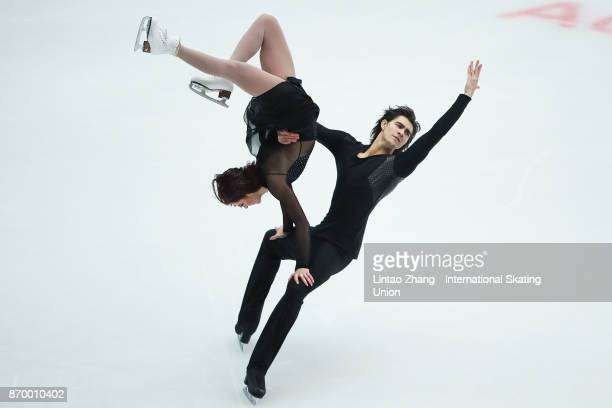 Elliana Pogrebinsky and Quinn Carpenter of the United States reacts after compete in the Ice Dance Free Dance on day two of Audi Cup of China ISU...