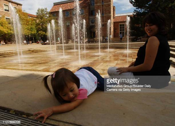 Elliana Smith 20 months plays with her mother Jaimie Smith a parttime Longmont resident at CU's Dalton Trumbo Fountain on Friday The fountain has...