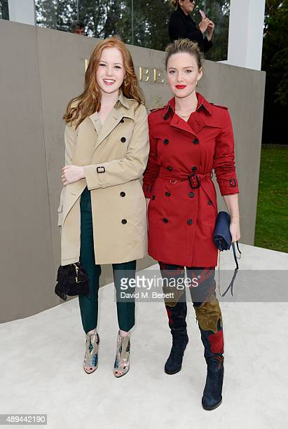 Ellie Bamber and Holliday Grainger arrive at Burberry Womenswear Spring/Summer 2016 show during London Fashion Week at Kensington Gardens on...