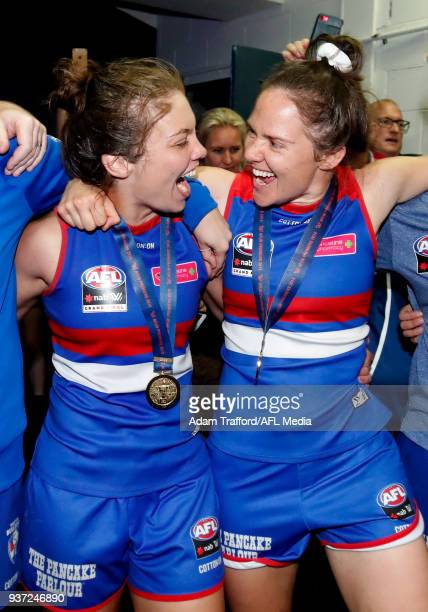 Ellie Blackburn and Emma Kearney of the Bulldogs sing the team song during the 2018 AFLW Grand Final match between the Western Bulldogs and the...
