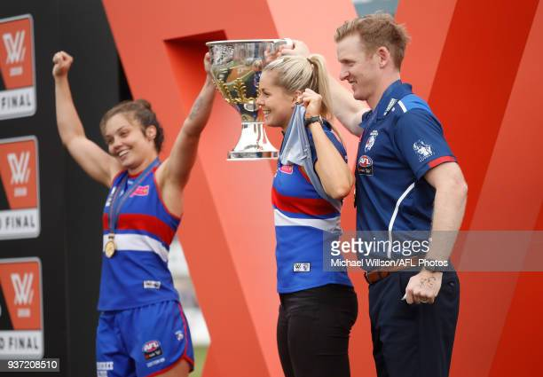 Ellie Blackburn Katie Brennan and Paul Groves Senior Coach of the Bulldogs celebrate after winning the 2018 AFLW Grand Final match between the...
