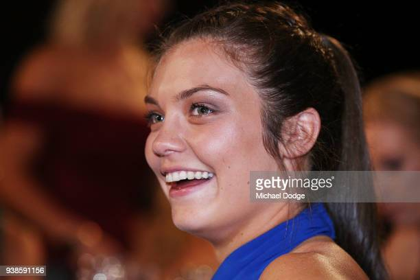 Ellie Blackburn looks on as Emma Kearney of the Bulldogs speaks after winning the AFLW Medal during the 2018 AFW Awards at The Peninsula on March 27...