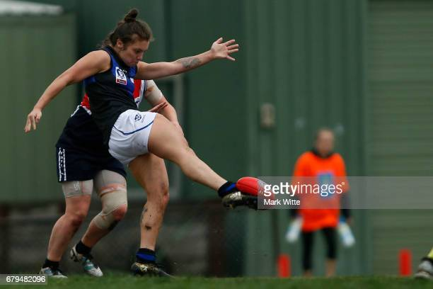 Ellie Blackburn of Melbourne Uni kicks the ball during the round one VFL Women's match between the Darebin Falcons and Melbourne Uni at Bill Lawry on...