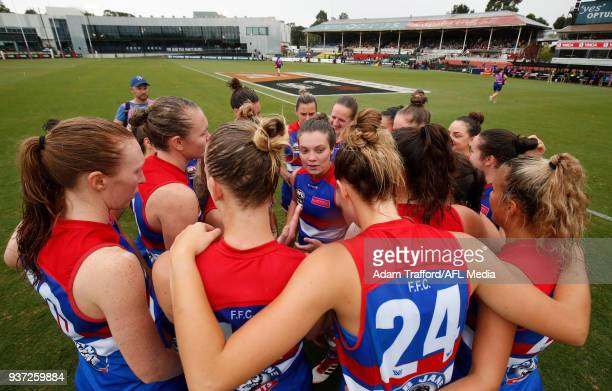 Ellie Blackburn of the Bulldogs addresses her teammates during the 2018 AFLW Grand Final match between the Western Bulldogs and the Brisbane Lions at...