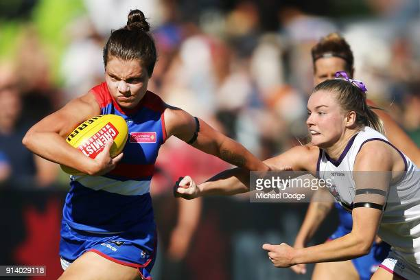 Ellie Blackburn of the Bulldogs brushes away Dana Hooker of the Dockers uring the round one AFLW match between the Western Bulldogs and the Fremantle...