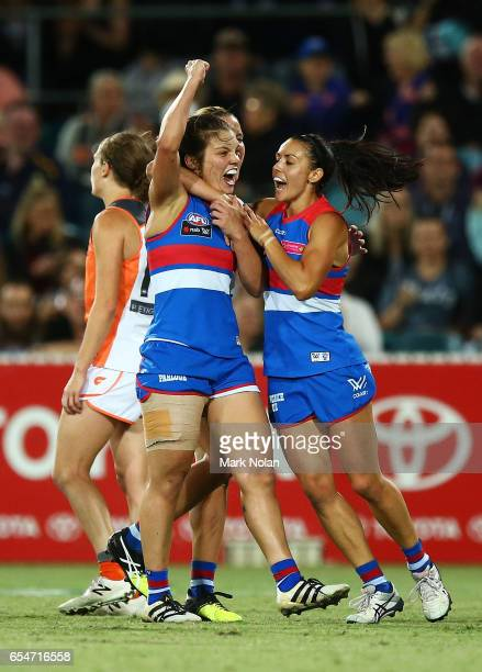 Ellie Blackburn of the Bulldogs celebrates kicking a goal on the full time siren during the round seven AFL Women's match between the Greater Western...