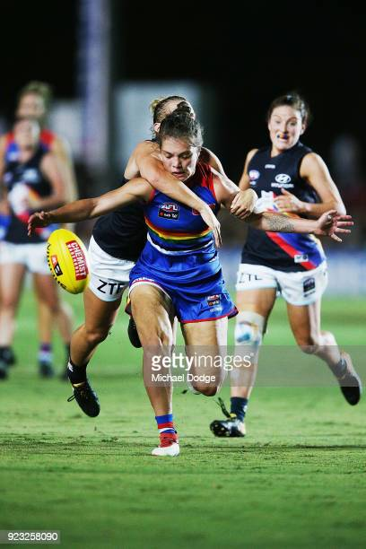 Ellie Blackburn of the Bulldogs gets tackled during the round four AFLW match between the Western Bulldogs and the Carlton Blues at Whitten Oval on...