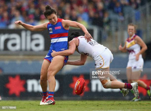 Ellie Blackburn of the Bulldogs is tackled by Leah Kaslar of the Lions during the AFLW Grand Final match between the Western Bulldogs and the...