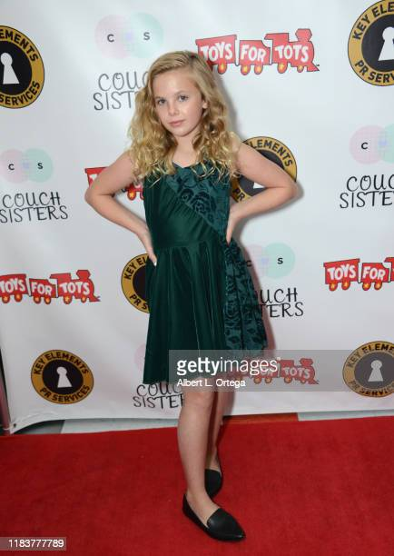 Ellie Blue attends The Couch Sisters 1st Annual Toys For Tots Toy Drive held onNovember 20 2019 in Glendale California
