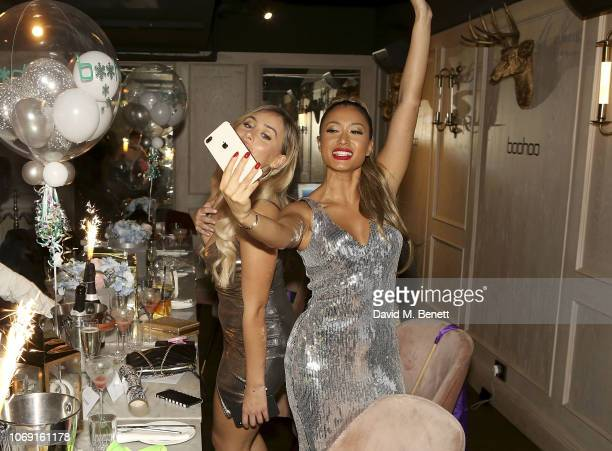 Ellie Brown and Kaz Crossley attend the Boohoo Celebrity Christmas Night Out at the Menagerie Restaurant and Bar on December 6 2018 in Manchester...